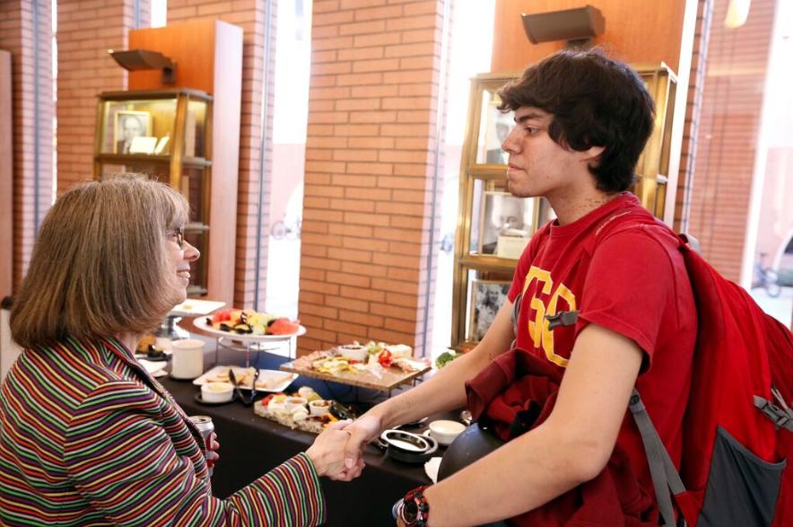 Marko greets Dr. Sally (Sarah) Pratt, vice provost for graduate programs